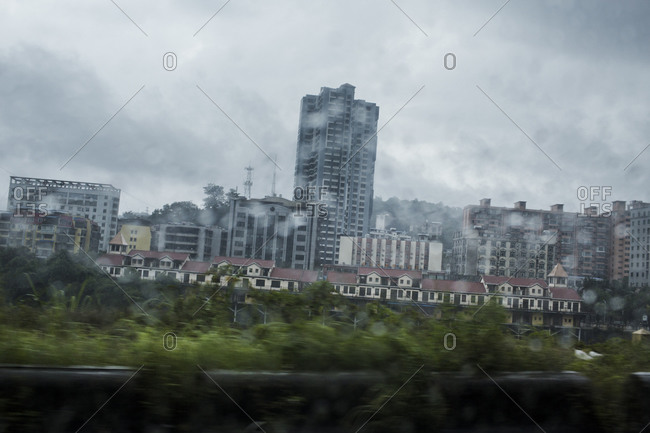 A view of Hekou, China as scene through the rainy window of a taxi in Lao Cai, Vietnam