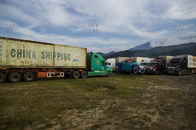 Lao Cai, Vietnam - June 22, 2015: Trucks filled with perishable goods sit idling with their engines on for several days near the infamous Kilometer Zero border crossing from Vietnam into China