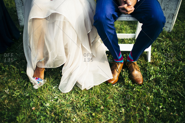 A bride and groom sitting outside during their wedding in Nova Scotia, Canada