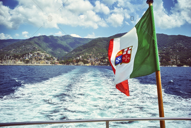 Stern of a ship with Genoese flag on the sea, Liguria