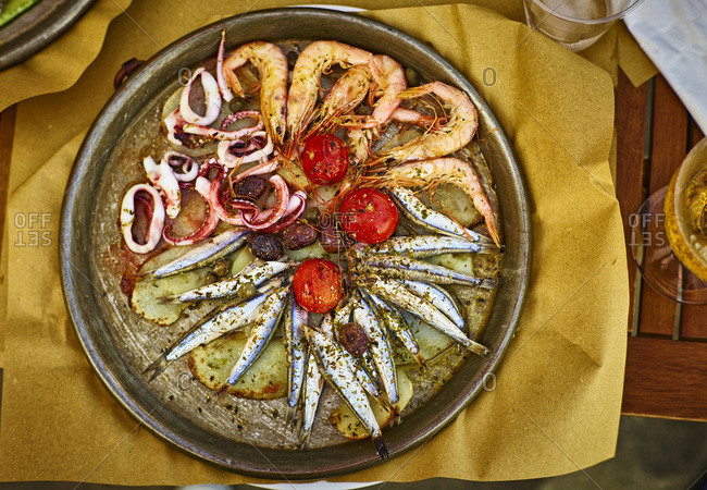 Fish dish Genoese on hot serving plate