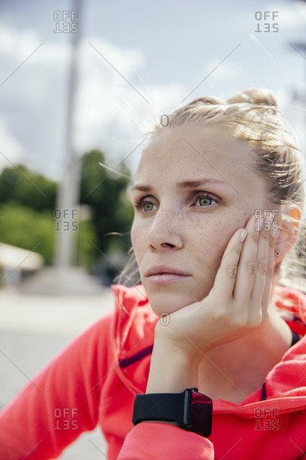Young sporty woman with smart watch