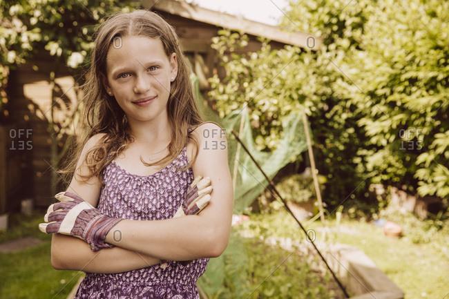 Portrait of confident girl in garden