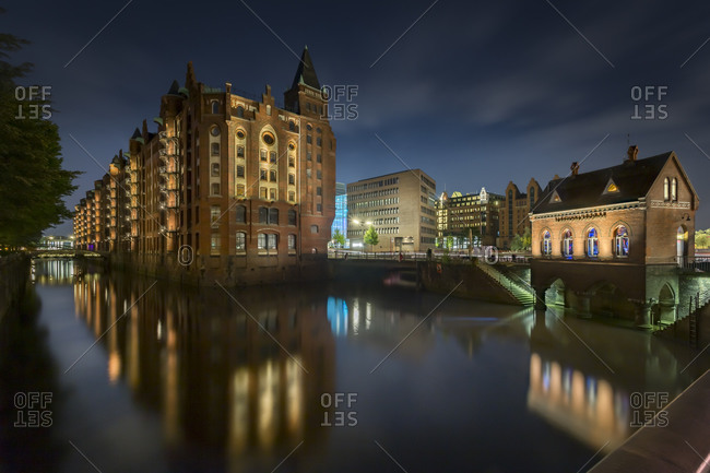 Hamburg, Germany - July 12, 2015: Hollaendischer Brook with historic warehouses and the Fleetschloesschen, Hamburg