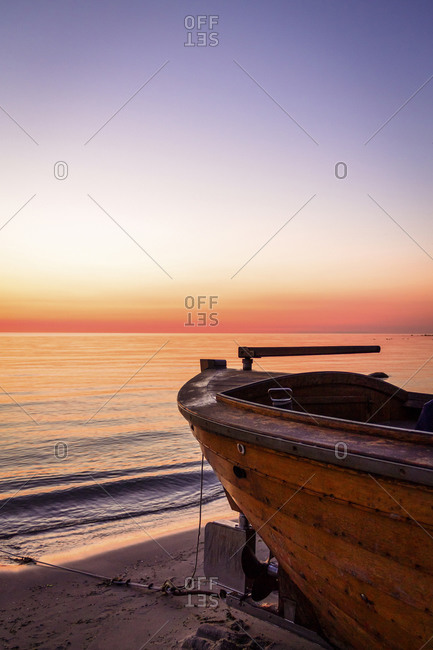 Boat on beach at sunrise, Ruegen