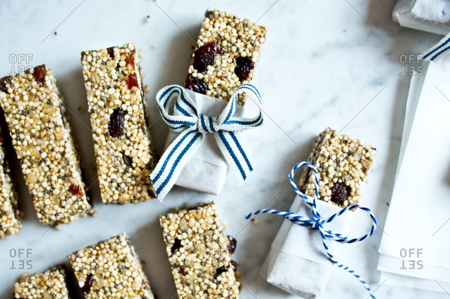Homemade quinoa bars getting wrapped