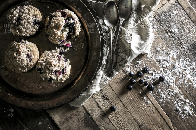 Overhead view of blueberry muffins on a rustic tabletop