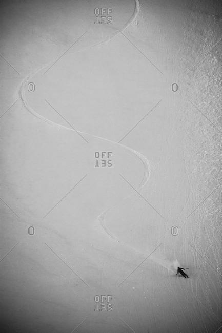 Tiny speck of a skier speeding down a slope in Colorado