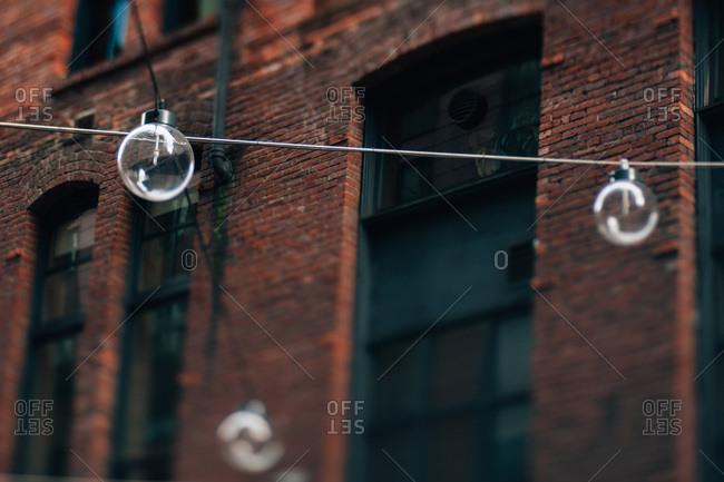 Strung lights and brick facade