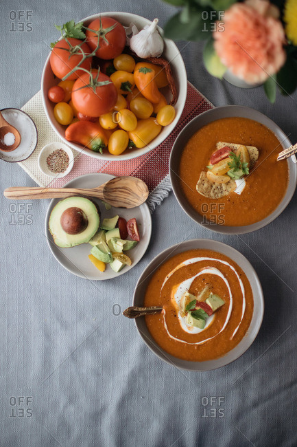 Bowls of tortilla soup and ingredients