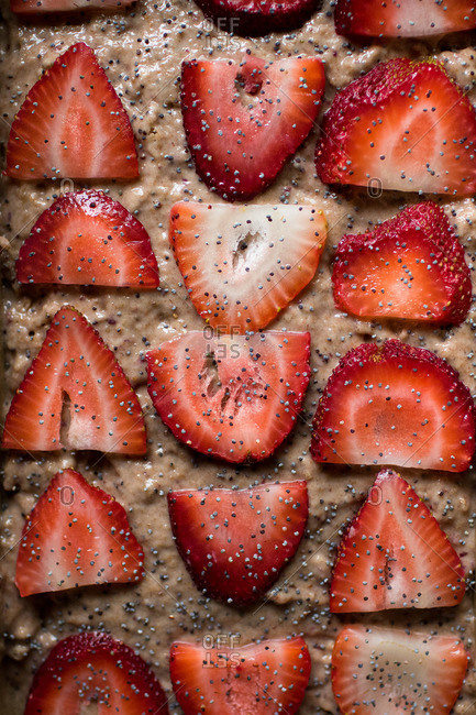 Slices of strawberries on raw batter