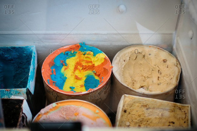 Various ice cream flavors in a parlor freezer