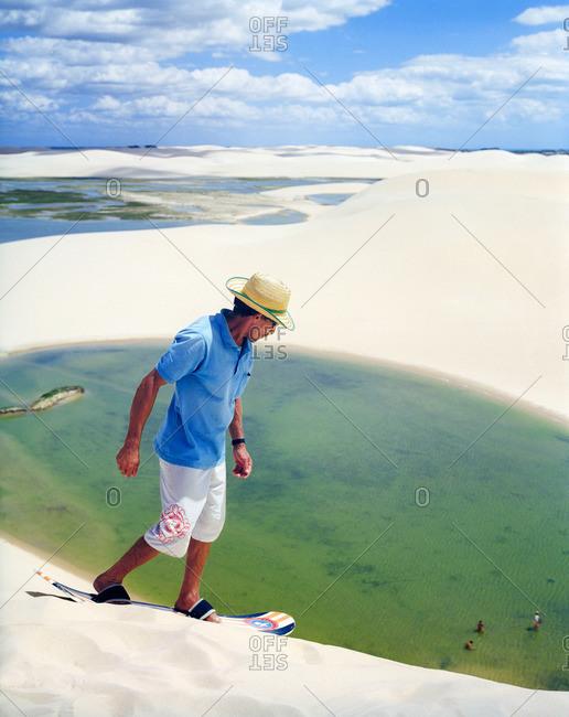 Dunas Tatajuba,�Jericoacoara, Brazil - June 19, 2007: Sand boarder on top of dune in Brazil