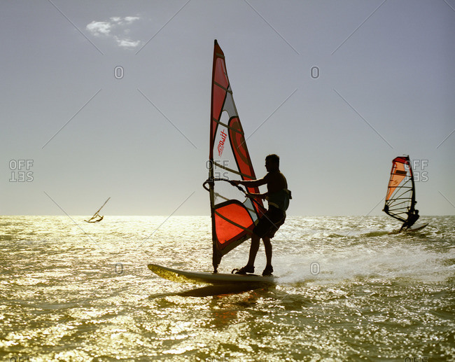 Jericoacoara, Brazil - June 20, 2007: Windsurfers at sunset in Brazil