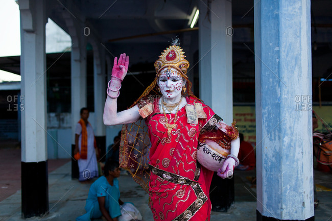 Jalpaiguri, West Bengal, India - August 2, 2015: A Bahurupi artist inside a Hindu temple