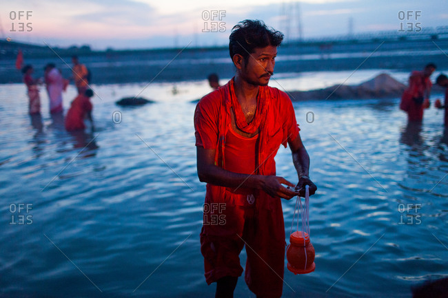 Jalpaiguri, West Bengal, India - August 2, 2015: A devotee bathing and collecting water from river