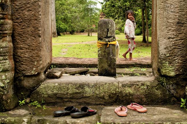 Angkor, Cambodia - September 15, 2012: A girl in Angkor, Cambodia