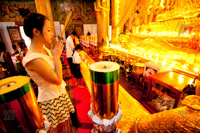Phnom Penh, Cambodia - October 1, 2012: A Cambodian woman praying at the temple, Phnom Penh