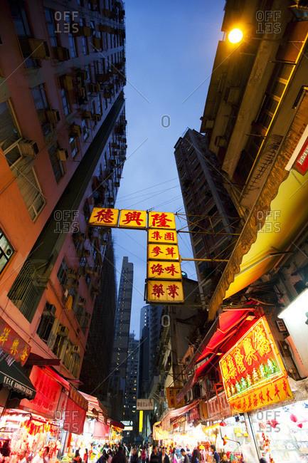 Hong Kong, China - February 4, 2012: Lighted Hong Kong street In the evening
