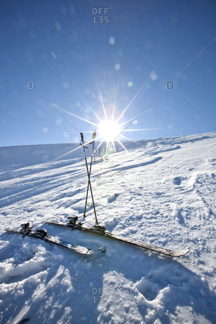 Skis and poles on a snow covered slope