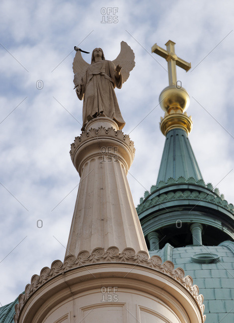 Angel and cross atop spires at St. Nicholas Church, Potsdam, Germany