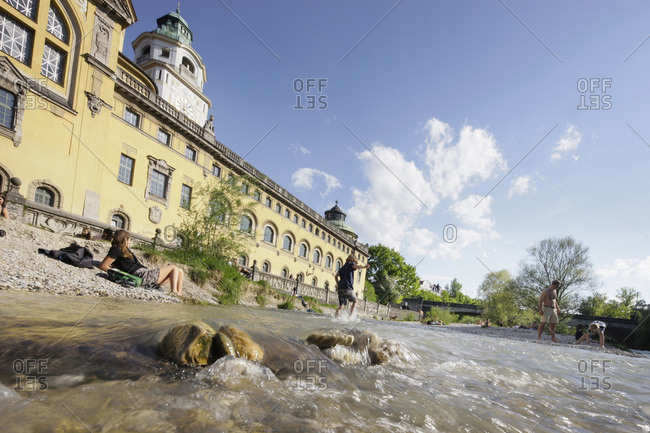 Munich, Germany - May 2, 2012: People playing in the Isar River in Munich, Germany