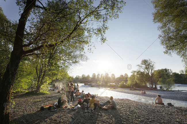 Munich, Germany - May 4, 2012: People hanging out on the Isar River in Munich, Germany