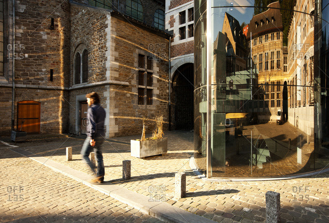 Man walking past the entrance to the Museum of Walloon Life in Liege, Belgium
