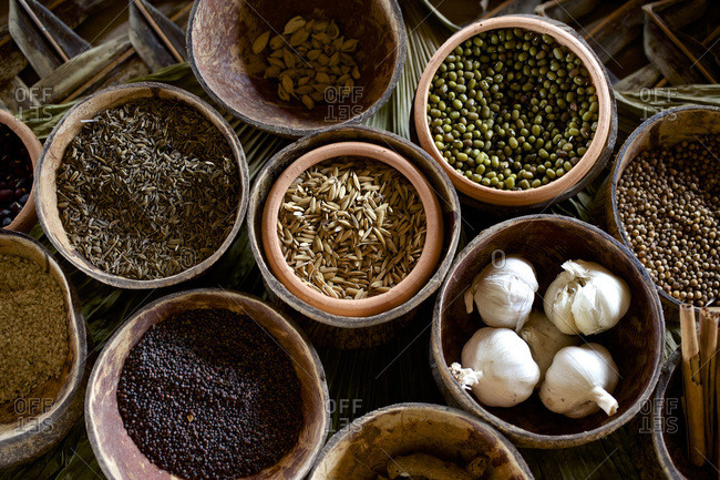 Earthenware bowls of herbs and spices