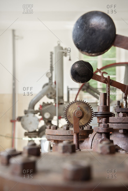 Gears and levers on an antique water supply pump in Blaubeuren, Germany