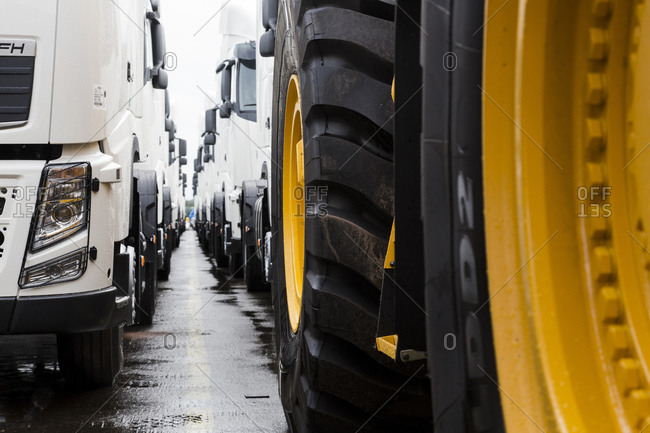 Parked construction vehicles and tractor trailers