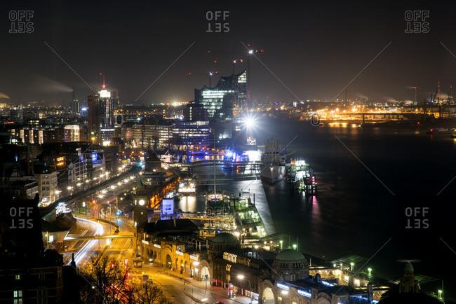 Hamburg harbor and construction of Elbe Philharmonic Hall at night