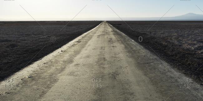 A road through a barren land in San Pedro de Atacama, Antofagasta Region, Chile