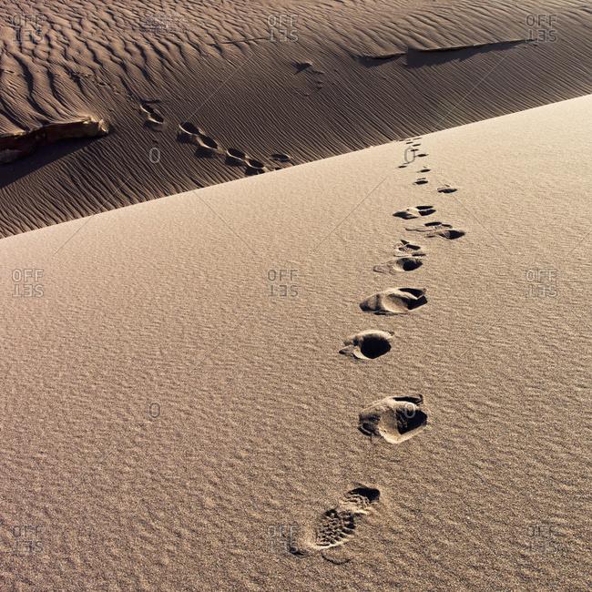 Footprints in the sand, Valle de la Luna, Salar de Atacama in San Pedro de Atacama, Antofagasta Region, Chile