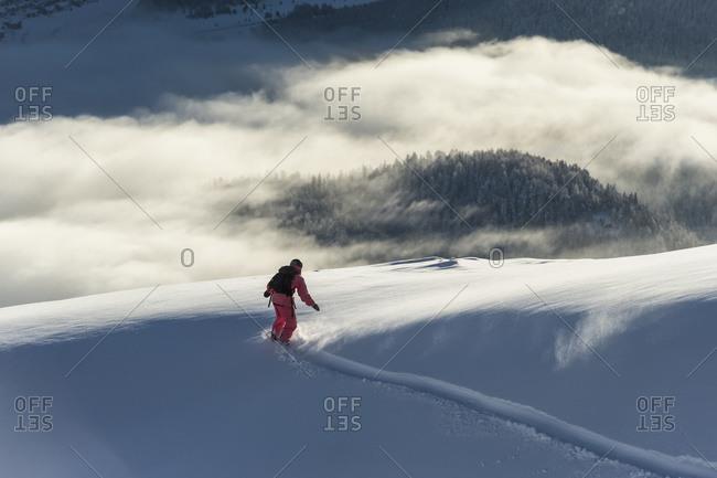 Snowboarding above the clouds in St. Moritz, Graubunden, Switzerland