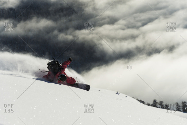 Snowboarding on powder snow in St. Moritz, Graubunden, Switzerland