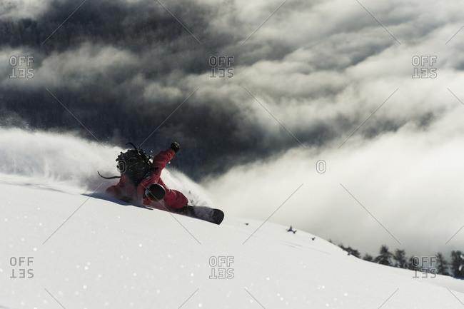 Snowboarding on powder snow in St. Moritz, Graubunden, Switzerland