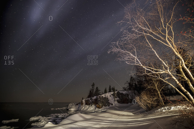 Night sky with stars over Lake Superior in winter in Grand Portage, Minnesota