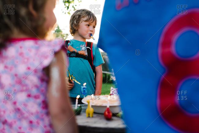 A boy celebrates his birthday outside