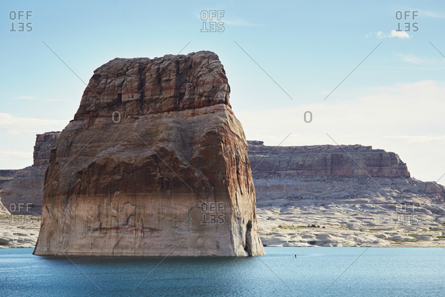 Lone Rock jutting from lake water