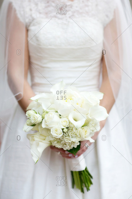 Bride in gown with rose bouquet