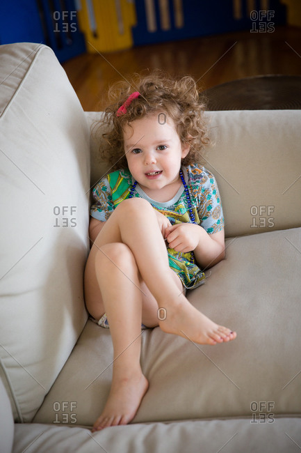 Little girl lying on a couch