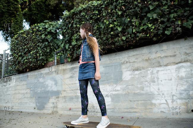Girl standing on a skateboard
