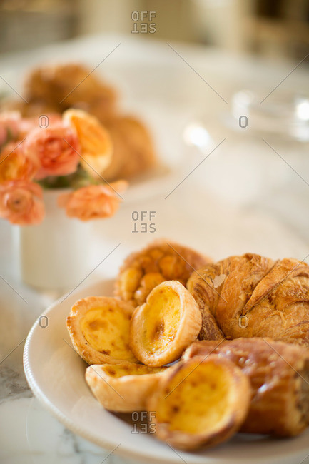 Close-up of pastries and mini quiches