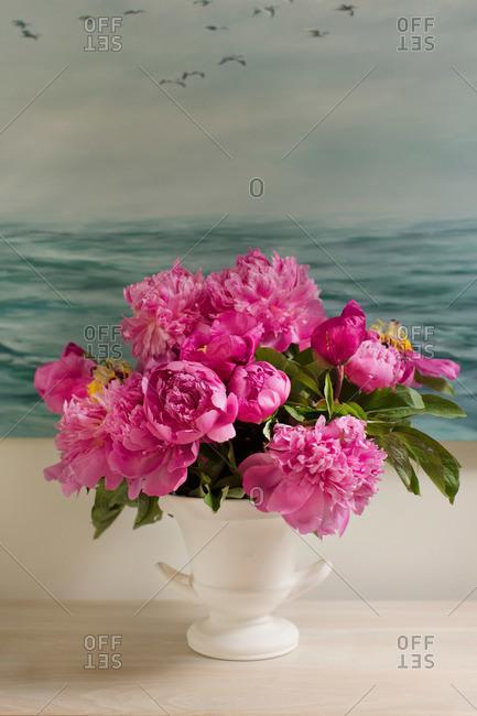 Bright pink peonies in a vase