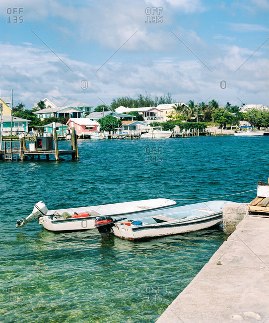 Motor boats along a dock in Elbow Cay, Bahamas