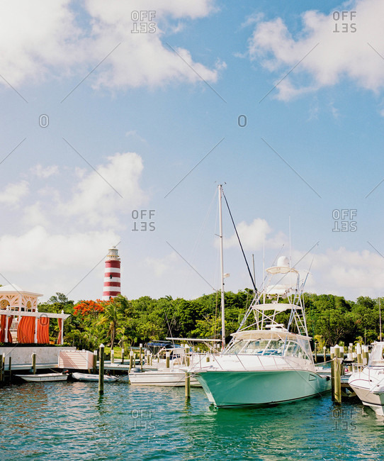 Elbow Cay marina in the Bahamas with lighthouse in background