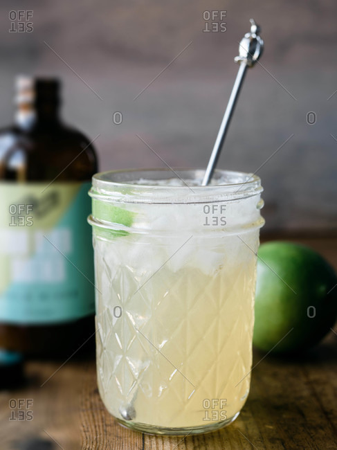 Lime juice cocktail served in a glass jar
