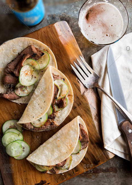 Grilled flank steak tacos with sliced cucumbers