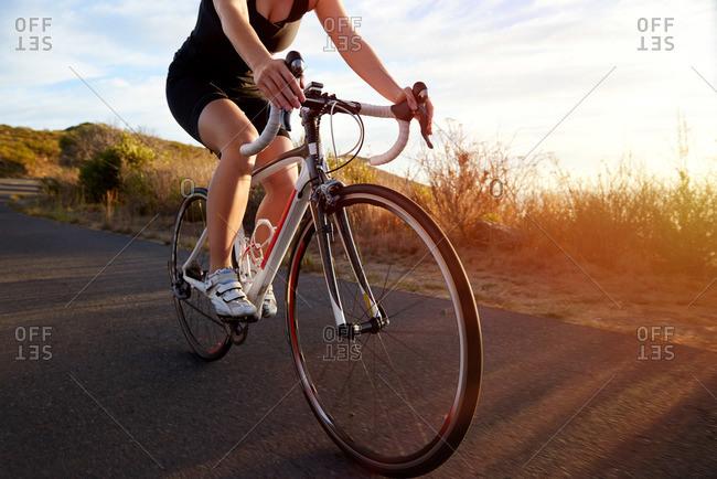 Woman biking on a mountain road